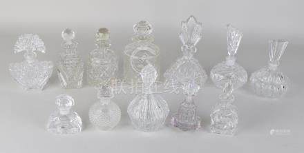 Twelve times various white bottles with various sharps