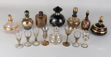 Eight times various stopper bottles, most with gold rim