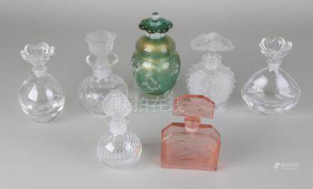 Seven times glass / crystal vials, one of which is pink