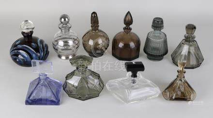 Ten different glass or crystal bottles in various