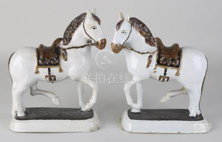 Two 18th-century Delft polychrome horses. Restored.