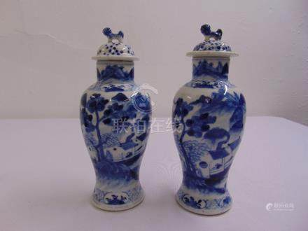 A pair of Chinese blue and white baluster vases with pull off covers