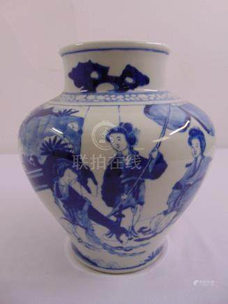 A Chinese blue and white baluster vase decorated with figures in a garden