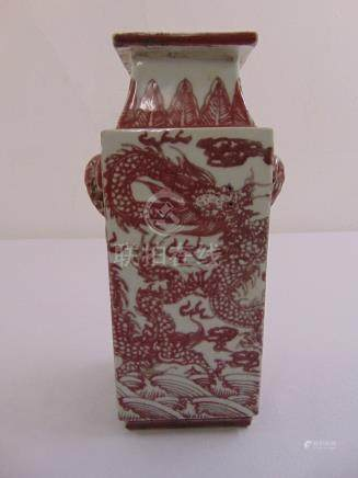 A Chinese rectangular vase with elephant mask side handles, decorated with dragons and bats