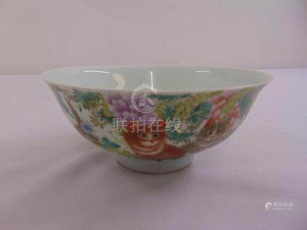 A Chinese republic period hand painted bowl decorated with a cat, flowers and leaves