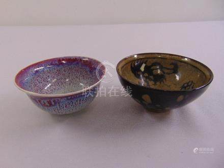 Two Chinese tea bowls on rimmed feet
