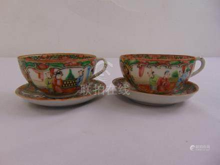 A pair of Chinese famille rose tea cups and saucers
