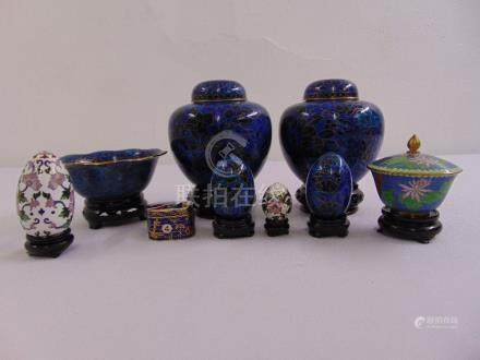 A quantity of cloisonné to include two ginger jars, covered boxes, a dish and four eggs (9)