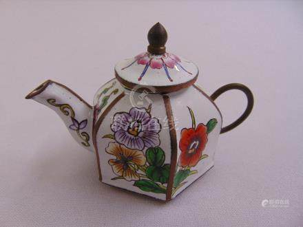 A Chinese enamel hexagonal miniature teapot decorated with flowers and leaves