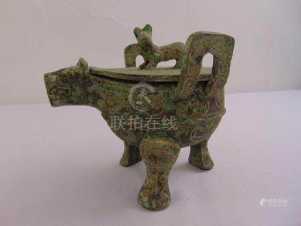 A Chinese bronze incense burner in the form of a stylised animal with pull off cover all on three