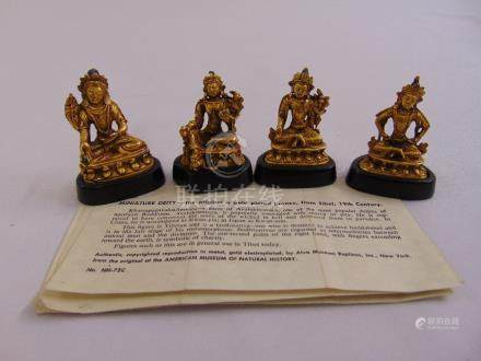 Four miniature gold plated Deities mounted on raised lotus thrones to include Vasudhara,