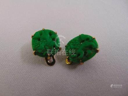 A pair of Chinese 14ct gold and jade earrings