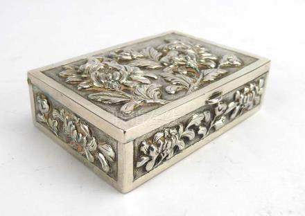 A Japanese metalware box of rectangular form repousse decorated with peony in full bloom,
