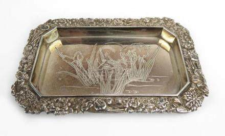 A small Japanese metalware tray of canted rectangular form centrally engraved with irises within a