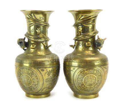 A pair of Chinese brass vases of baluster form,
