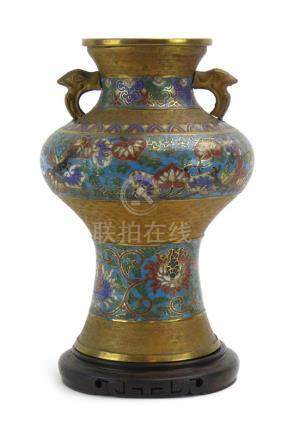 A Chinese cloisonne two handled vase of slender bellied form decorated with stylised flowerheads on