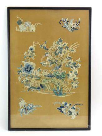 A Chinese silk embroidery depicting a pair of birds of paradise within a foliate landscape, 60 x 39.