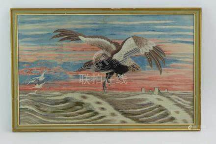 A longstitch embroidery depicting an eagle in flight over a squally sea at sunset, 36 x 57.
