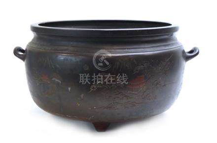 A Japanese brown patinated bronze two handled cauldron of typical form,