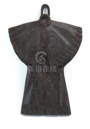 A Chinese wood carving modelled as a hanging robe, l. 48.