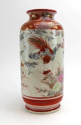 A Kutani vase of cylindrical form decorated with pheasants within a blossoming landscape,