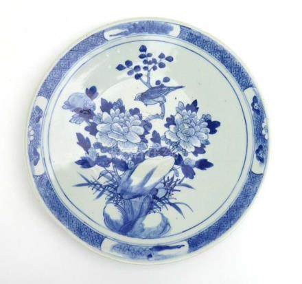 A Chinese blue and white charger centrally decorated with a bird at rest, d.