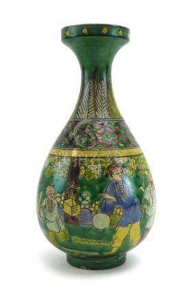 A Chinese vase of slender ovoid form decorated with processional figures within a green ground,