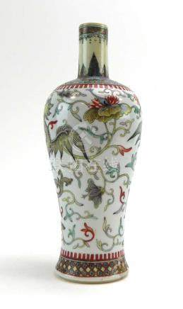 A Chinese vase of baluster form decorated in coloured enamels with dragons within a scrolled ground,