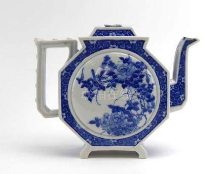 A Chinese blue and white teapot and cover of octagonal form decorated with floral sprays,