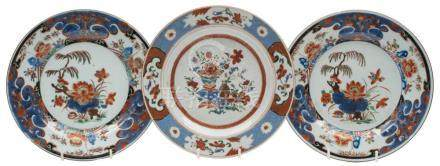 A pair of Chinese verte Imari plates and one other: the pair painted with lotus,