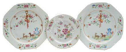 A pair of Chinese famille rose plates and one other: the pair painted with a stag and doe,