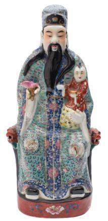 A Chinese famille rose figure of Shou Lao: the seated Immortal wearing elaborate blue and turquoise