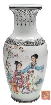A Chinese porcelain vase: of baluster form decorated with two elegant ladies in a garden setting
