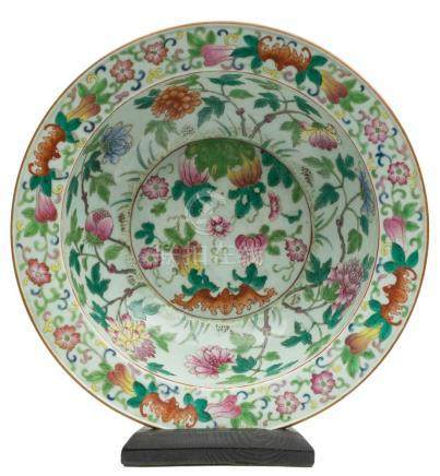 A Chinese export famille rose basin: with flattened everted rim, painted with bats, peony sprays,