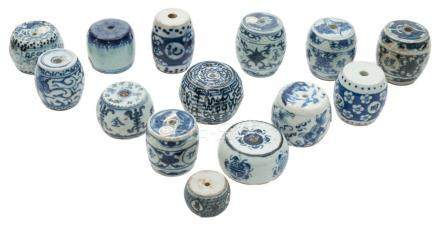 A collection of fourteen Chinese blue and white porcelain scroll weights: of barrel form,