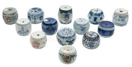 A collection of thirteen Chinese porcelain scroll weights: of barrel form,