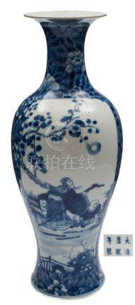 A Chinese porcelain vase: of slender baluster form with flaring neck painted in blue with a panel