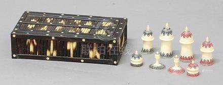 INDIAN MUSLIM PATTERN CHESS SET, 19th century, decorated with red and black circular motifs,