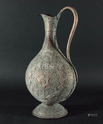 QAJAR COPPER EWER, Persian, 19th Century, of flattened baluster form decorated in relief with