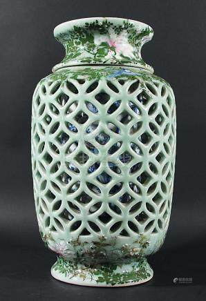 JAPANESE CELADON RETICULATED VASE AND LINER, 20th century, the vase with mon piercing between blue