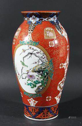 JAPANESE BALUSTER VASE, late 19th century, painted with roundels of birds in flowers prunus branches