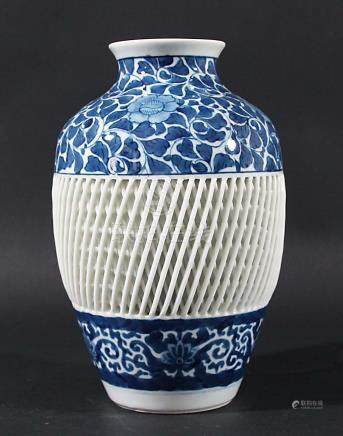 JAPANESE BLUE AND WHITE VASE, 20th century, of ovoid form with a broad band of lattice work