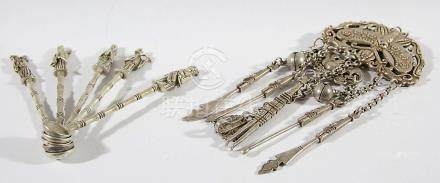 SET OF EIGHT CHINESE WHITE METAL SPOONS, the finials cast as Immortals; together with a Chinese