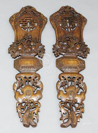 PAIR CHINESE HARDWOOD PANELS, with carved and pierced decoration, a winged bat above an elemental