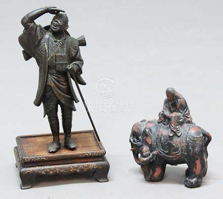 BRONZE FIGURE OF A TRAVELLER, probably Chinese, standing looking upwards, height 23cm; together with