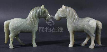 PAIR OF CHINESE GREY GREEN JADE HORSES, with white speckles, height 13cm, length 14.5cm (2)