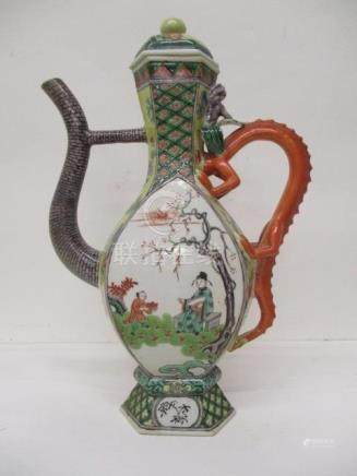 A late 19th century Chinese famille verte hexagonal ewer and cover with a dragon handle, on a
