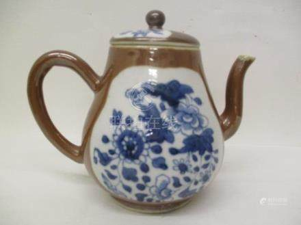 A 19th century Chinese porcelain ovoid teapot with a domed lid decorated with panels of flowers in