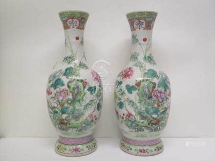 A pair of late 19th century Chinese famille verte ovoid vases, with flared necks, decorated with