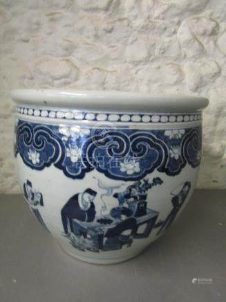 A 19th century Chinese porcelain blue and white planter, with a flat rim above a rounded body,